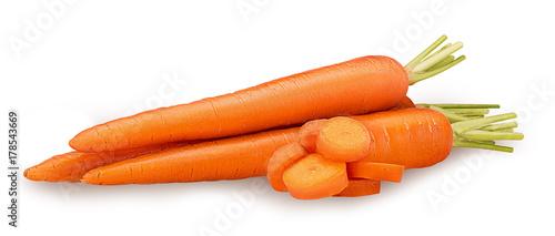 Papiers peints Légumes frais Heap of fresh clean carrots with slices, green stems.