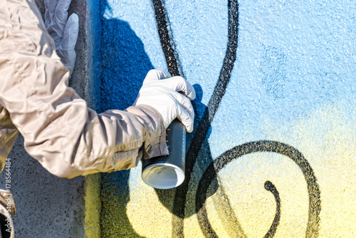 Blue graffiti is sprayed on the wall Poster