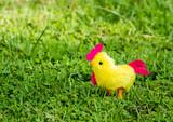 Chicken  toy in the grass