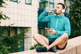 Man is relaxing after jogging - 178570000