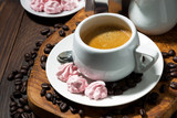 fresh espresso and pink meringues, top view