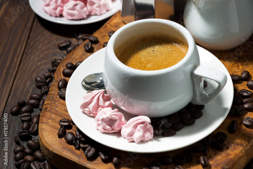 Poster fresh espresso and pink meringues, top view