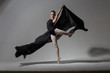 Graceful ballerina posing with black cloth