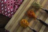 Turmeric powder, red chili powder, coriander powder on chopping - 178580866