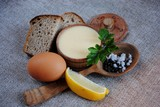 Mayonnaise sauce and ingredients on white wooden table. Top view - 178590202