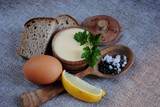 Mayonnaise sauce and ingredients on white wooden table. Top view - 178590223