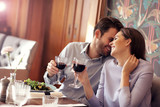 Romantic couple dating in restaurant - 178598242