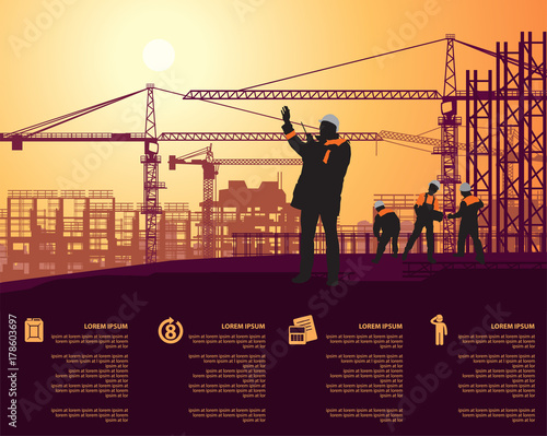 foreman in a white helmet talking on walkie talkie on construction site - 178603697