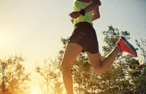 young fitness woman runner running on mountain top