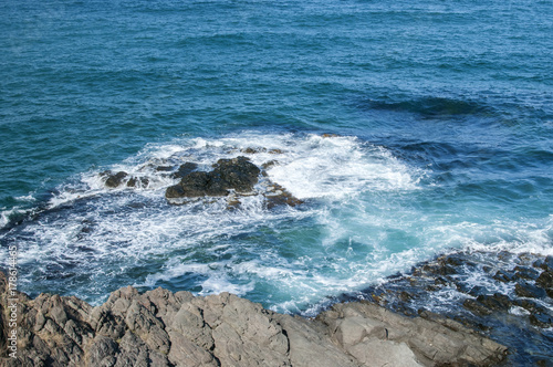Papiers peints Bleu jean Landscape of rocky seashore with blue calm waters in sunny summer day as natural background