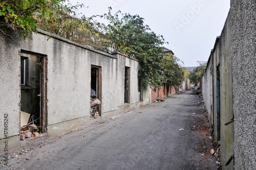 Back alley of derelict terraced houses ready to be demolished to make way for new homes