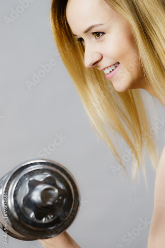 Fit woman lifting dumbbells weights Poster