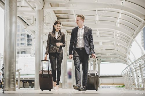 Foto Murales Business man and woman are going on business trip.