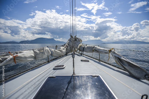 Fotobehang Schip A deck of yacht in the northern sea on a sunny summer day