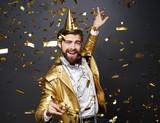 Businessman dancing among falling confetti