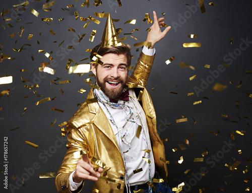 Businessman dancing among falling confetti - 178657242
