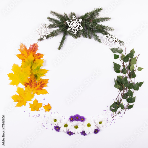 Wreath made of natural material, symbolizing the seasons of the year, on a white background Poster
