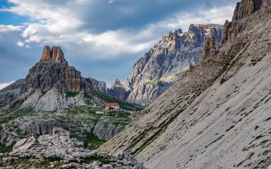 Tre Cime di Lavaredo refuge and mountain peaks at dusk