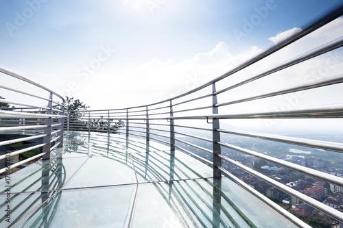 glass pedestrian bridge over hill
