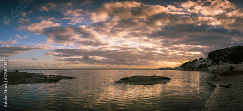 Foto op Canvas Grijze traf. A rock sticks out of a lagoon at sunset near Cape Town, South Africa