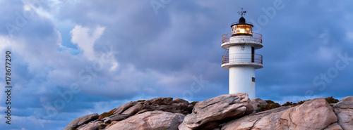 Fotobehang Vuurtoren Working Lighthouse at Bad Weather