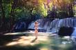 Female in bikini in nature waterfall
