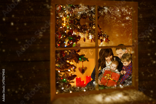 Christmas Window, Family Celebrating Xmas Holiday inside Home, Mother Father Child Baby