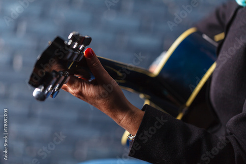 woman's hands playing acoustic guitar, close up Poster