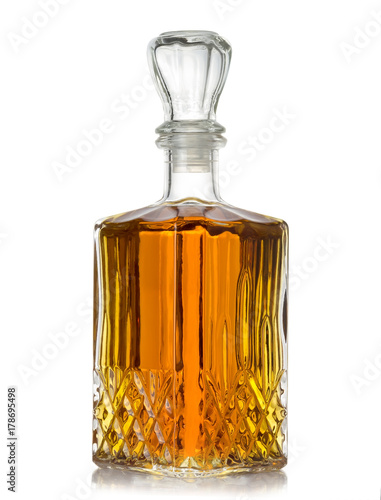 faceted bottle of cognac on white background