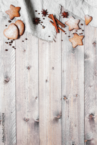 Wooden background with traditional ginger cookies and spices - 178696214