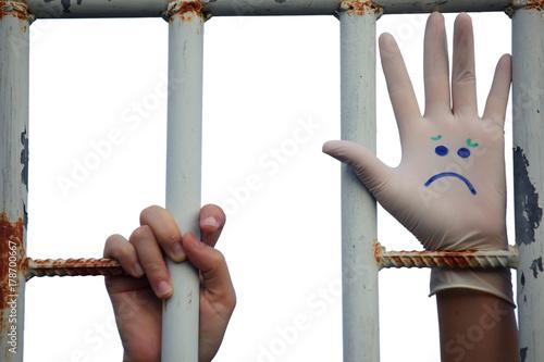 "emojicon ""sad"" face on hand of prisoner Poster"