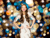 happy young woman in crown over festive lights