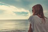 Girl enjoying the ocean tropical view scenery. - 178712035