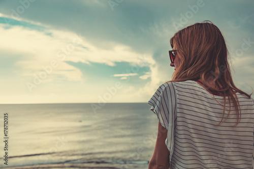 Girl enjoying the ocean tropical view scenery.