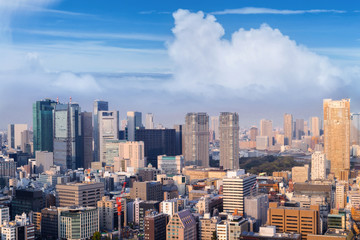 Aerial skyscraper view of office building and downtown and cityscapes of Tokyo city with blue sly and clouds background. Japan, Asia