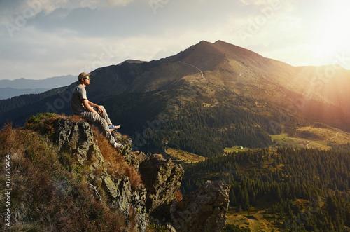 Fotobehang Grijze traf. hiker on peak mountain