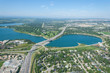 Aerial view of a city and highway running through man made reservoir. Calgary, Alberta, Glenmour Reservoir.