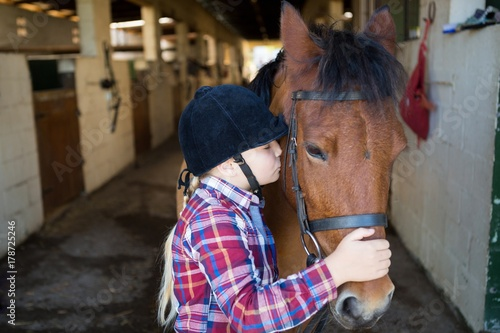 Girl kissing the horse Poster