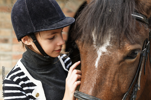 Teenage girl with her horse.