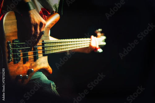Bassist pop rock during a performance at a concert - 178735293