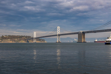 Bay Bridge, San Francisco, a view with the sea and reflections.