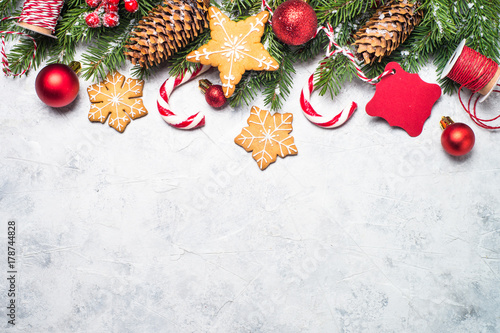 Fridge magnet Christmas background. Christmas gingerbread, snow fir tree and decorations.