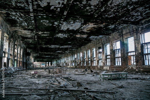 Fotobehang Gebouw in Puin Burned and destroyed interior of abandoned factory Red Triangle, Saint Petersburg