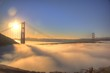 Spectacular Sunrise at Golden Gate Bridge with low fog.