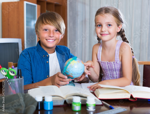 Portrait of children with textbooks