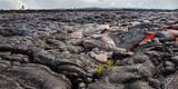 Massive flow of lava moves across rocky landscape - 178769435