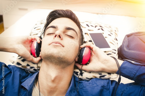 Fotobehang Muziek young listening to music with headphones