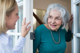 Woman Checking On Elderly Female Neighbor - 178786847