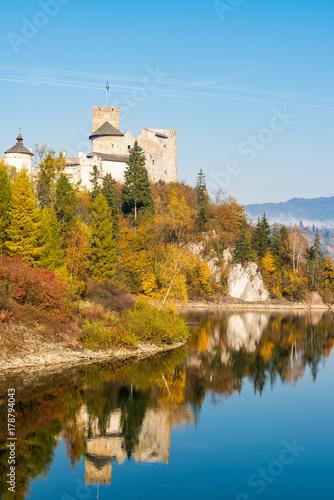 Nidzica Castle over lake in Poland