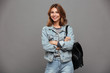 Portrait of a happy pretty girl in denim jacket
